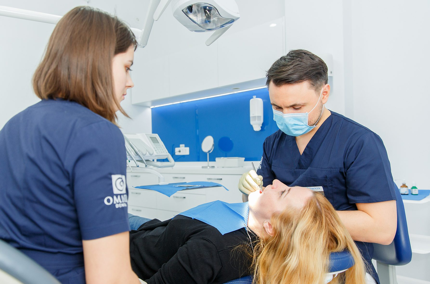 Doctor treating a patient with gum disease